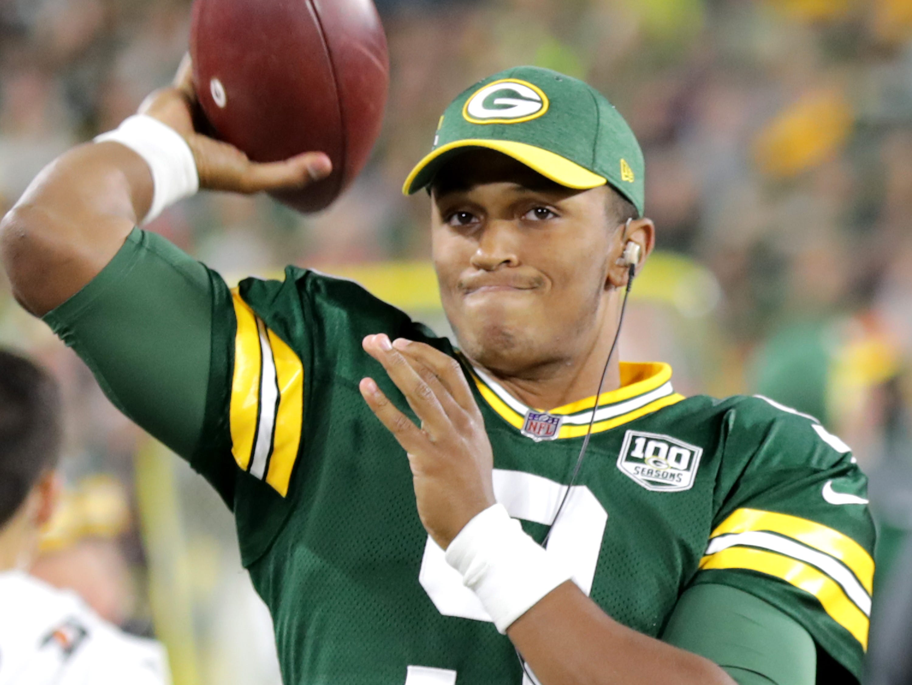 Green Bay Packers' DeShone Kizer warms up atewr Aaron Rodgers was carted of the field following a second quarter injury against the Chicago Bears in the season opener on Sunday, September 9, 2018, at Lambeau Field in Green Bay, Wis.