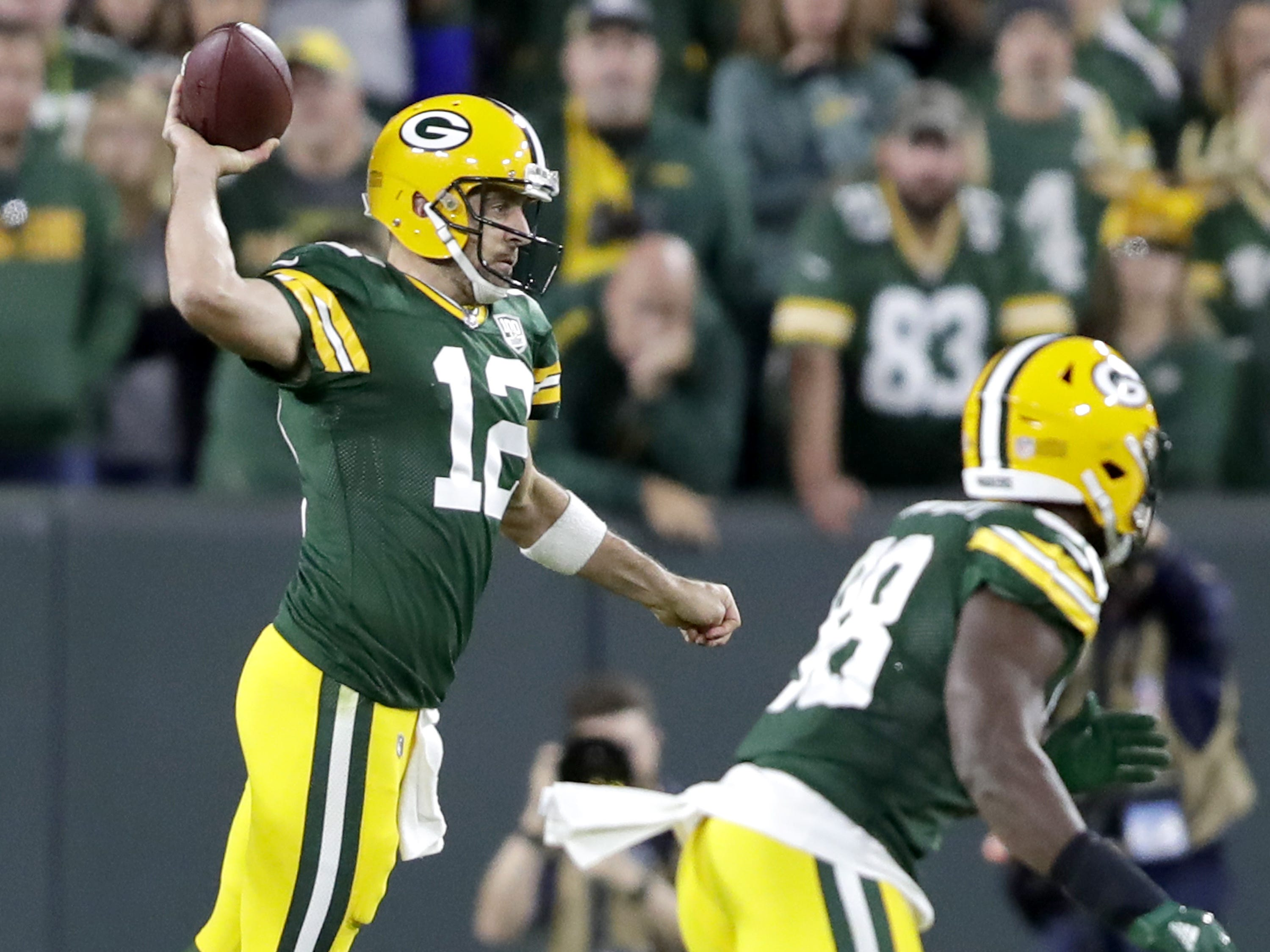 Green Bay Packers' Aaron Rodgers throws in the scond half against the Chicago Bears in the season opener on Sunday, September 9, 2018, at Lambeau Field in Green Bay, Wis. The Packers defeated the Bears 24 to 23.