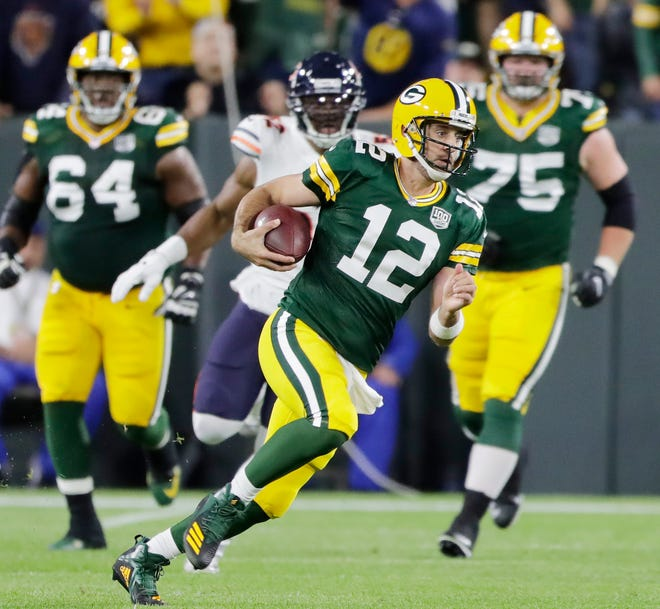 Green Bay Packers quarterback Aaron Rodgers (12) scrambles against the Chicago Bears in the first quarter at Lambeau Field on Sunday, September 9, 2018 in Green Bay, Wis.