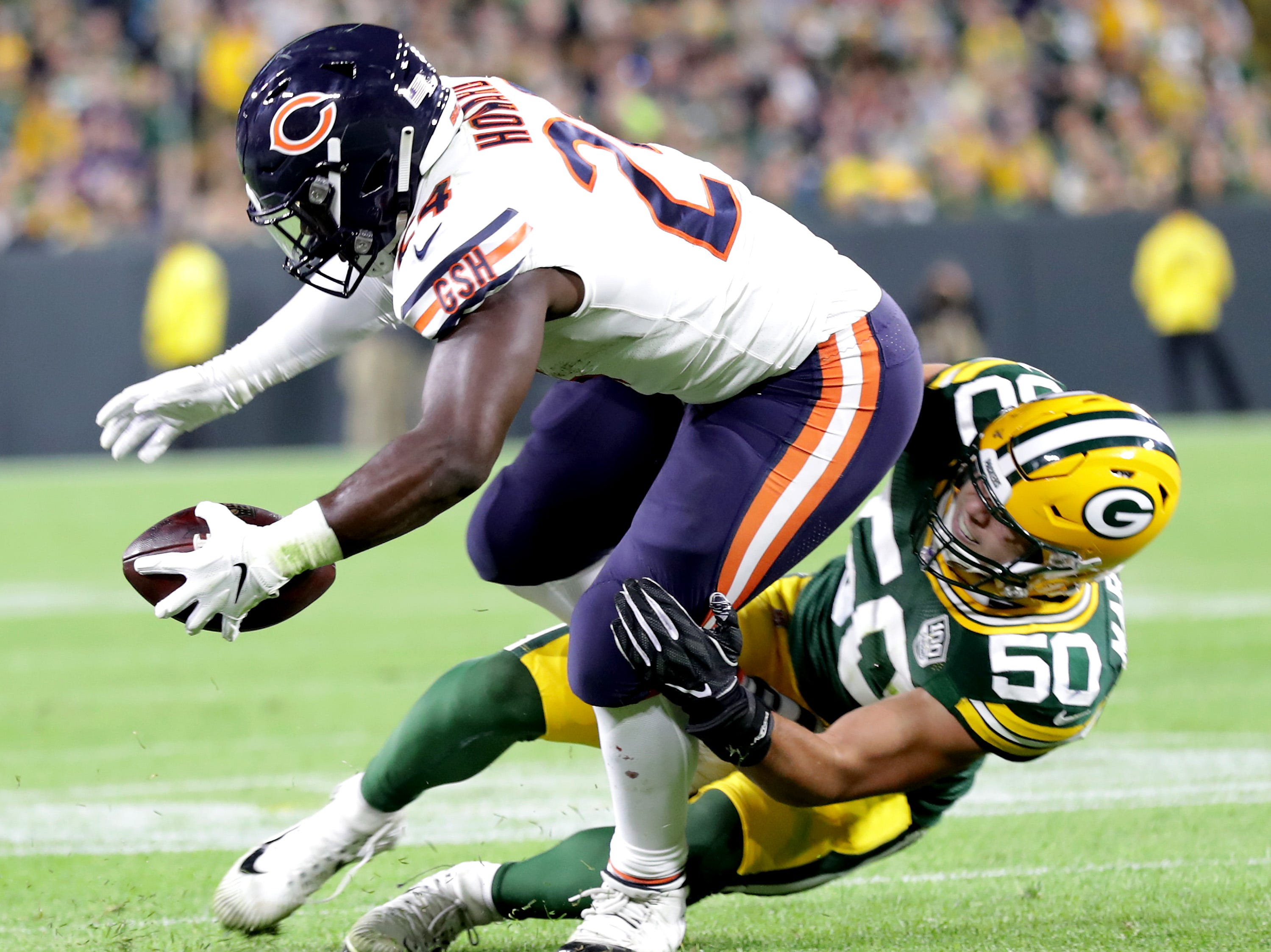 Green Bay Packers' Blake Martinez tackles Chicago Bears' Jordan Howard in the season opener on Sunday, September 9, 2018, at Lambeau Field in Green Bay, Wis. The Packers defeated the Bears 24 to 23.