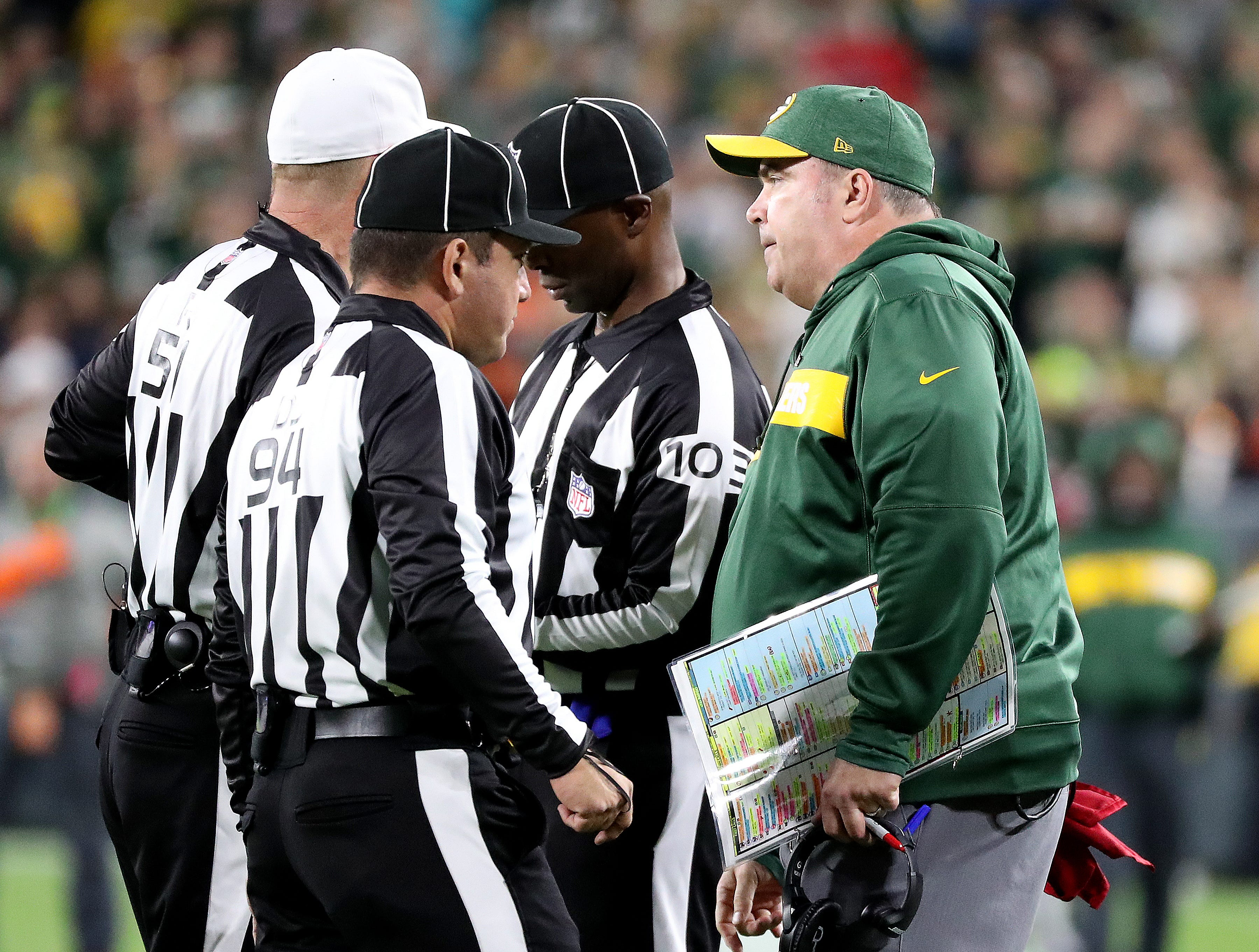Green Bay Packers head coach Mike McCarthy challenges a call in the fourth quarter against the Chicago Bears Sunday, September 9, 2018 at Lambeau Field in Green Bay, Wis.