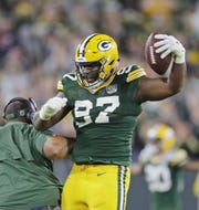 Green Bay Packers nose tackle Kenny Clark (97) reacts after recovering a fumble in the fourth quarter against the Chicago Bears at Lambeau Field on Sunday, September 9, 2018 in Green Bay, Wis. Adam Wesley/USA TODAY NETWORK-Wisconsin