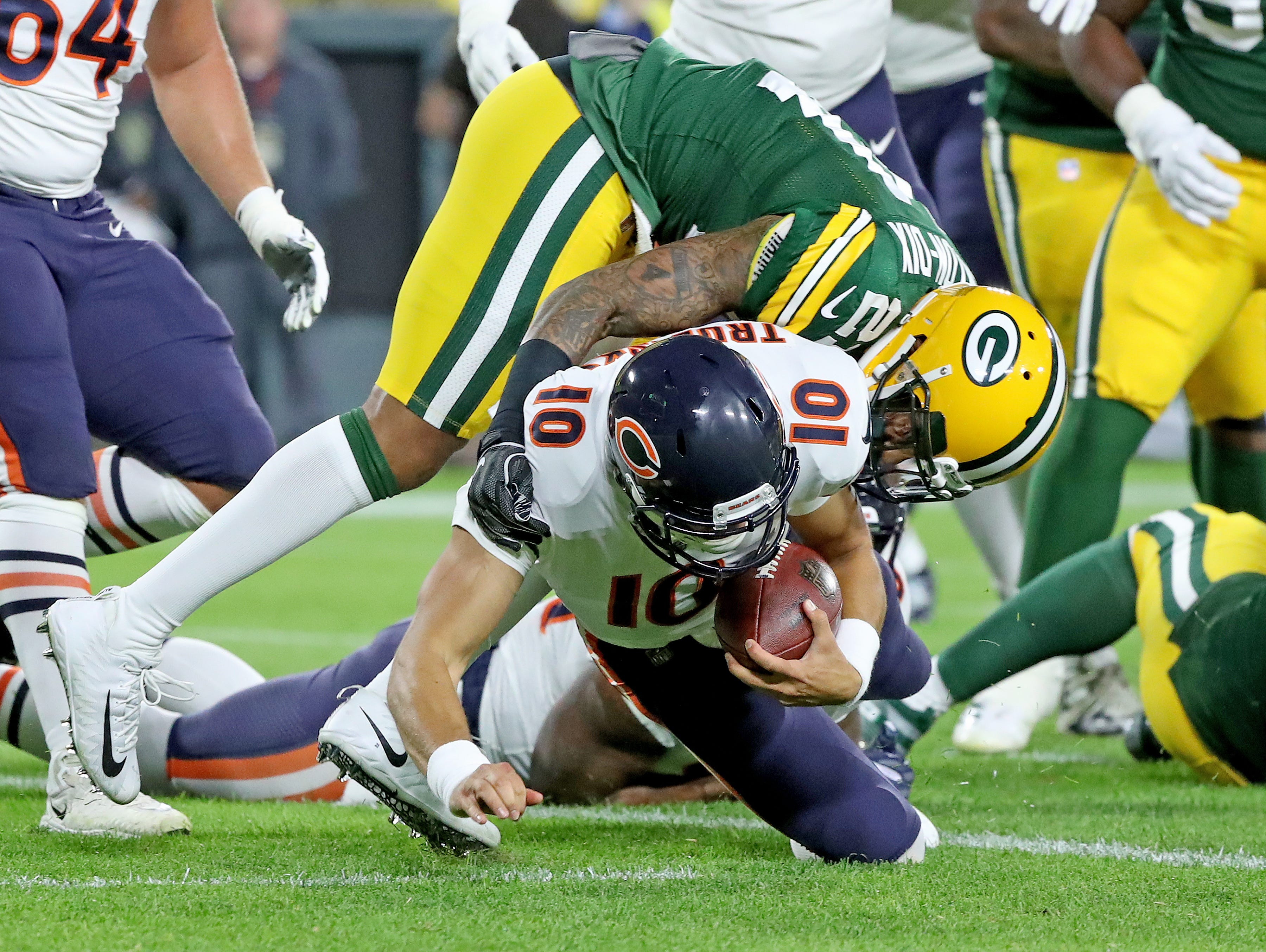 Green Bay Packers defensive back Ha Ha Clinton-Dix (21) can't stop quarterback Mitchell Trubisky (10) from scoring a touchdpwn in the first quarter against the Chicago Bears Sunday, September 9, 2018 at Lambeau Field in Green Bay, Wis.