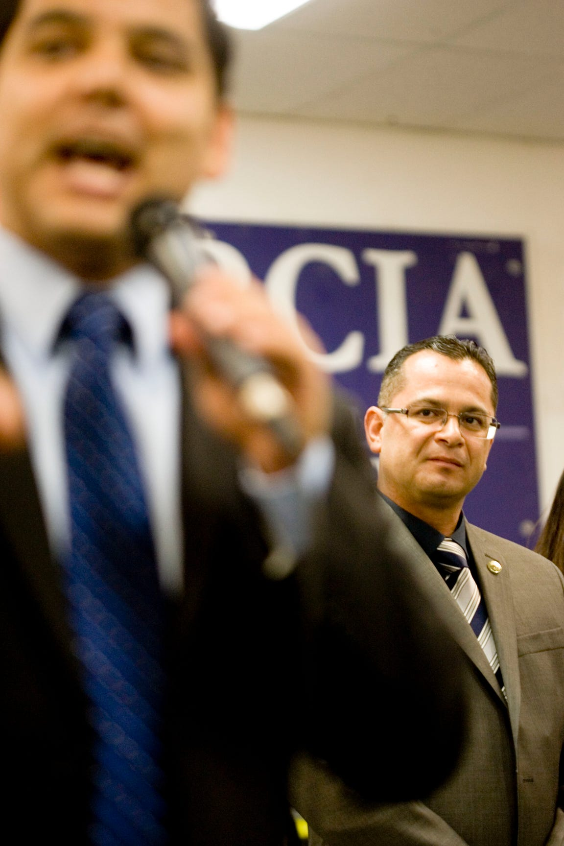 Assemblyman V. Manuel Perez observes Dr. Raul Ruiz as he speaks to supporters at the offices of Perez in the city of Coachella on election night November 6, 2012.