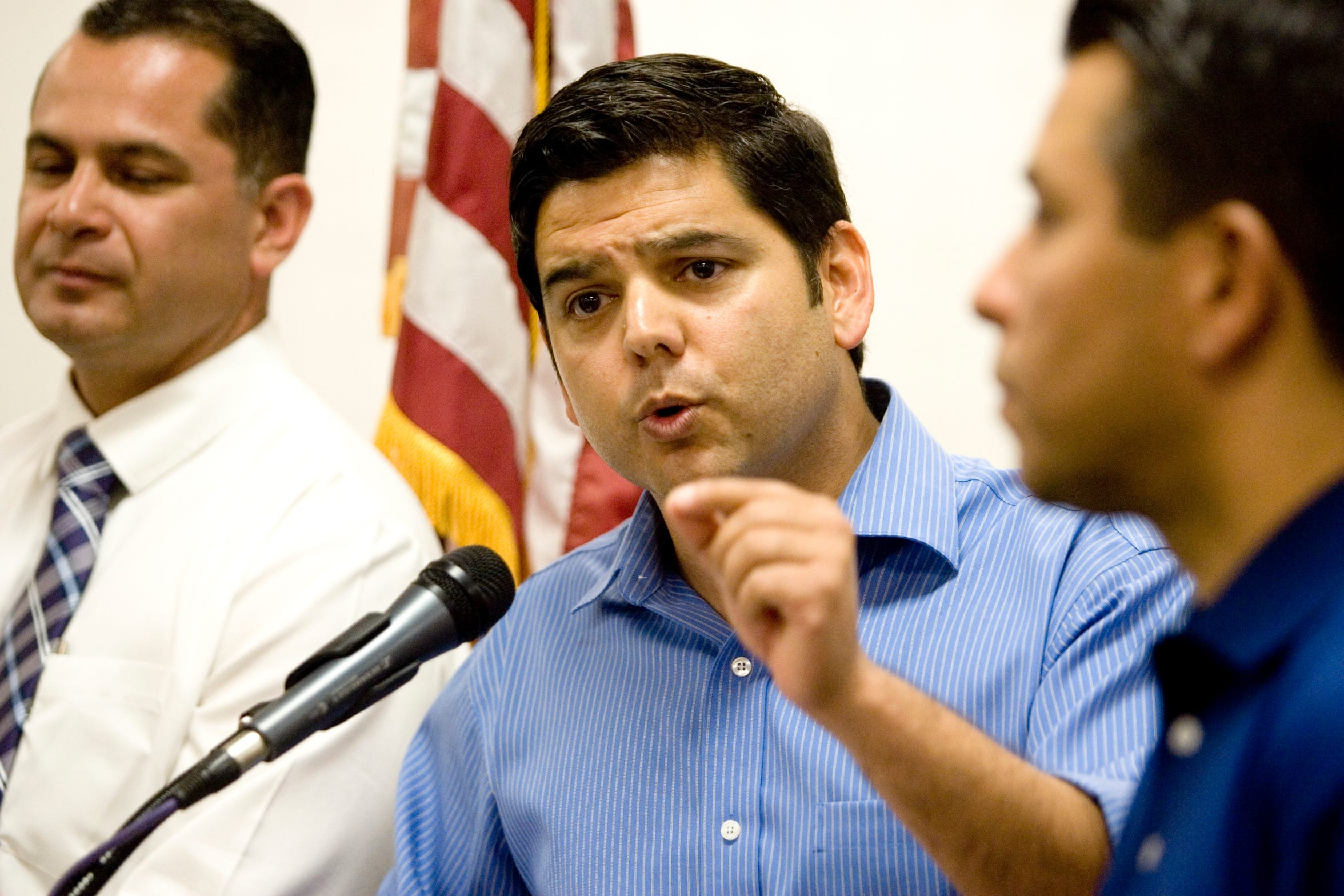 Congressman Raul Ruiz speaks at the opening of V. Manuel Perez's offices in the city of Coachella on September 25, 2012. At far left is Assemblyman V. Manuel Perez and at far right is Mayor of Coachella Eduardo Garcia.