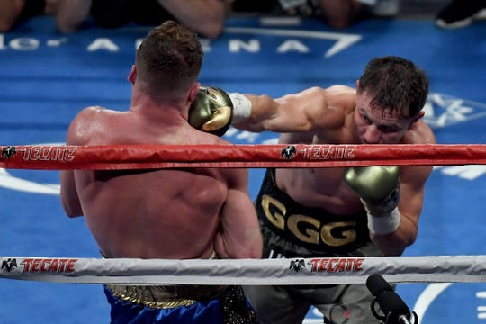 LAS VEGAS, NV - SEPTEMBER 16:  (R-L) Gennady Golovkin throws a punch at Canelo Alvarez during their WBC, WBA and IBF middleweight championship bout at T-Mobile Arena on September 16, 2017 in Las Vegas, Nevada.  (Photo by Ethan Miller/Getty Images)