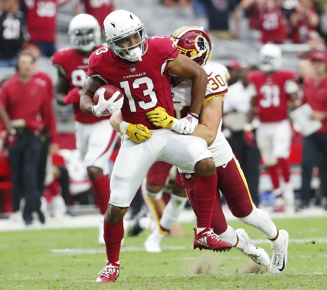 Arizona Cardinals' Christian Kirk (13) is tackled by Washington Redskins' Troy Apke (30) on a punt return during the fourth quarter at State Farm Stadium in Glendale, Ariz. September 9. 2018.