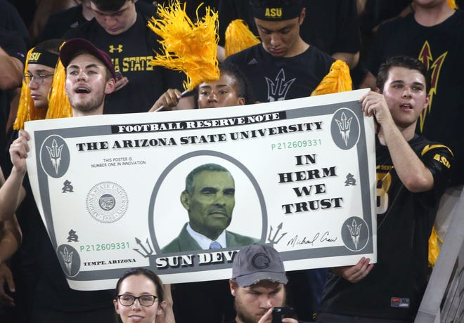 Arizona State fans salute head coach Herm Edwards against Michigan State in the second half on Sep. 8, 2018, at Sun Devil Stadium. College football pundits are also saluting the coach this week.
