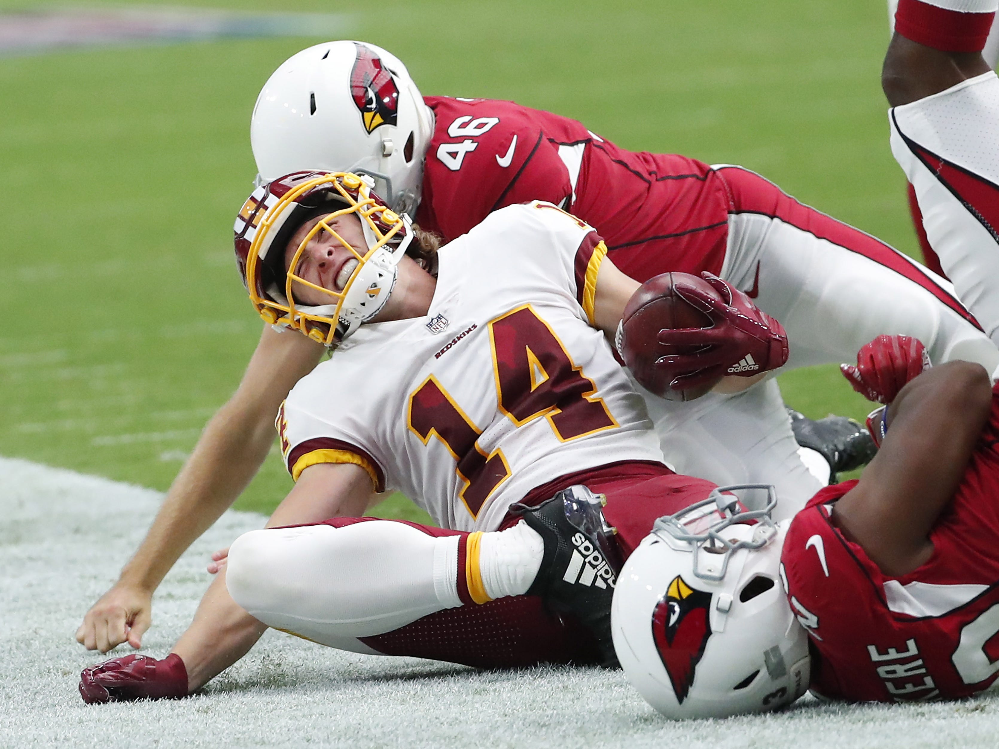 Washington Redskins punt returner Trey Quinn (14) gets injured during a return against the Arizona Cardinals during the third quarter at State Farm Stadium in Glendale, Ariz. September 9. 2018.