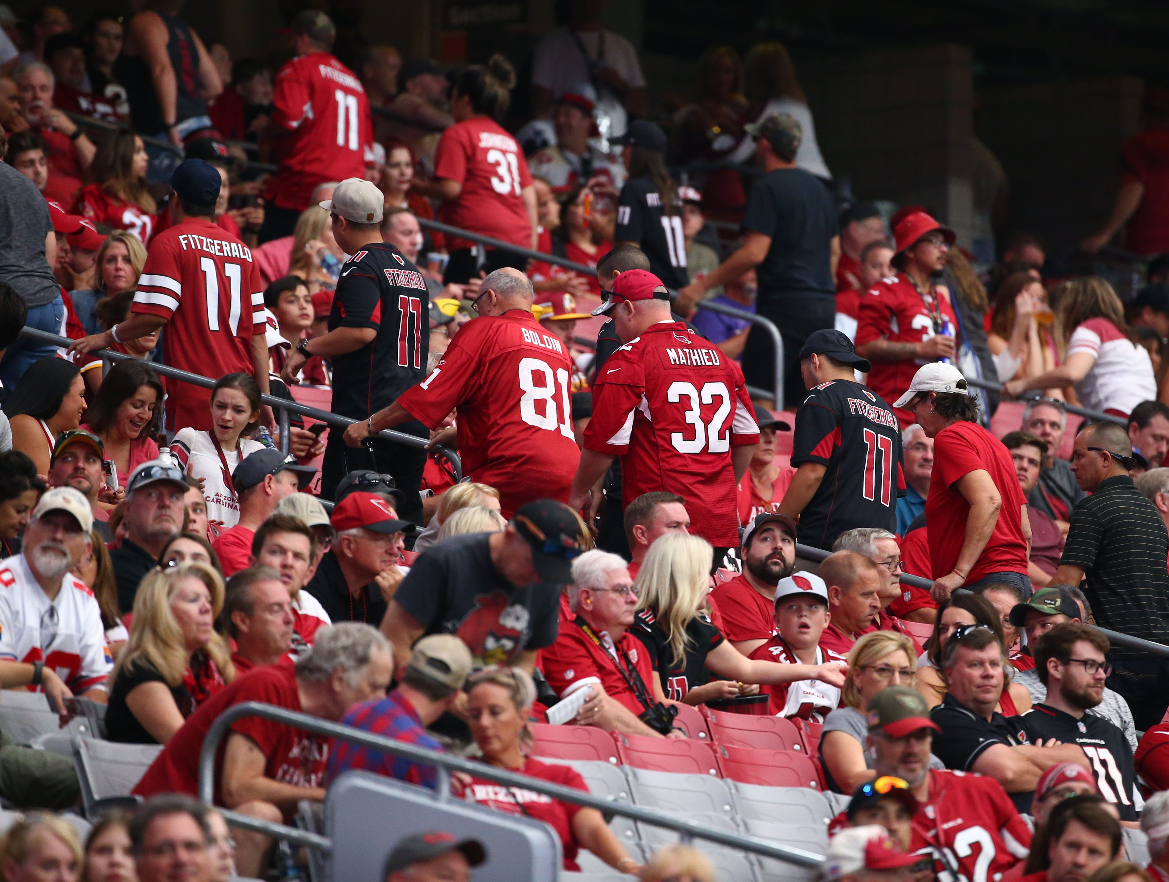 Fans head for the exits as the Arizona Cardinals lose to the Washington Redskins 24-6 at State Farm Stadium.