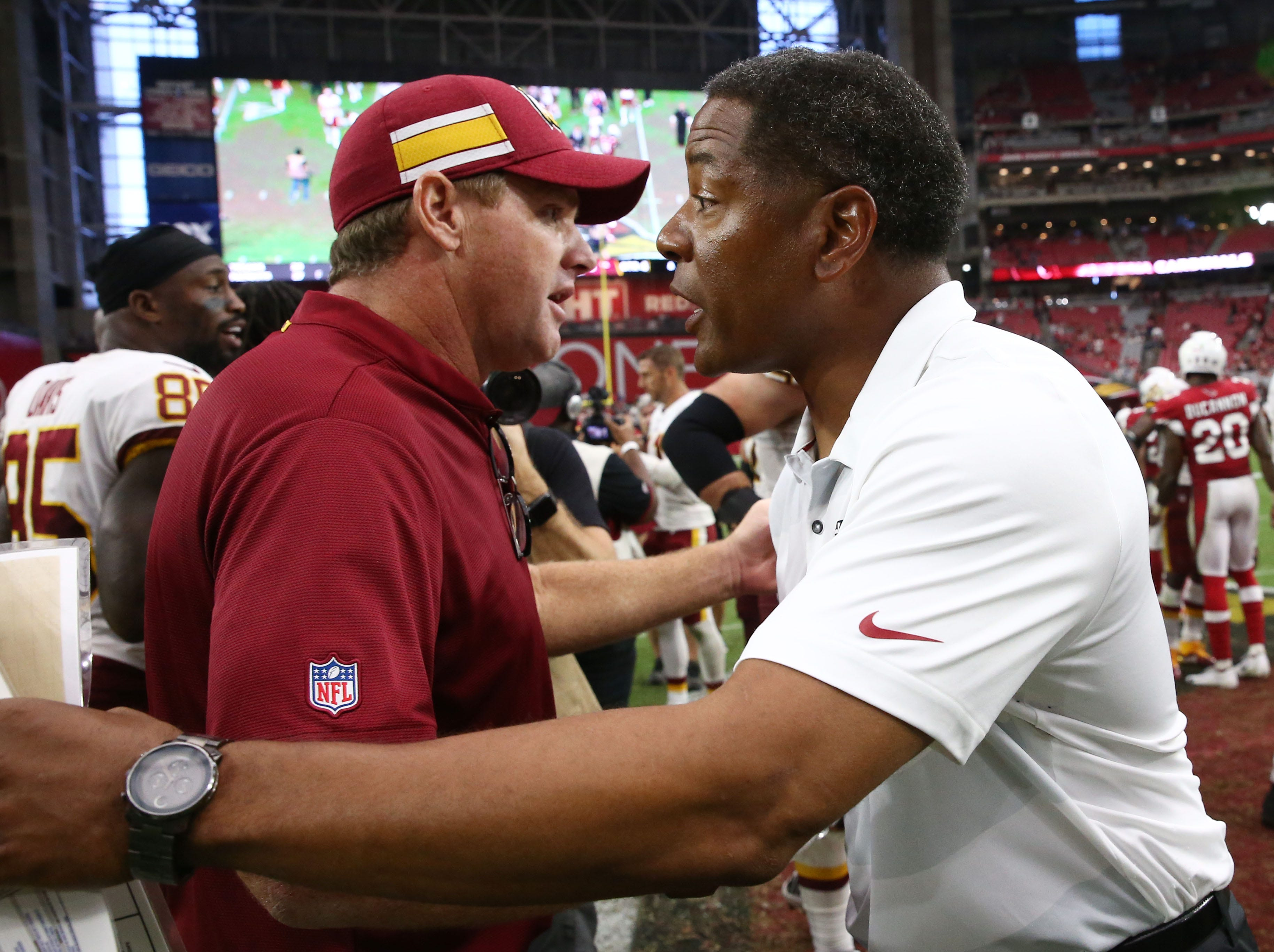 Arizona Cardinals head coach Steve Wilks greets Washington Redskins head coach Jay Gruden at State Farm Stadium.