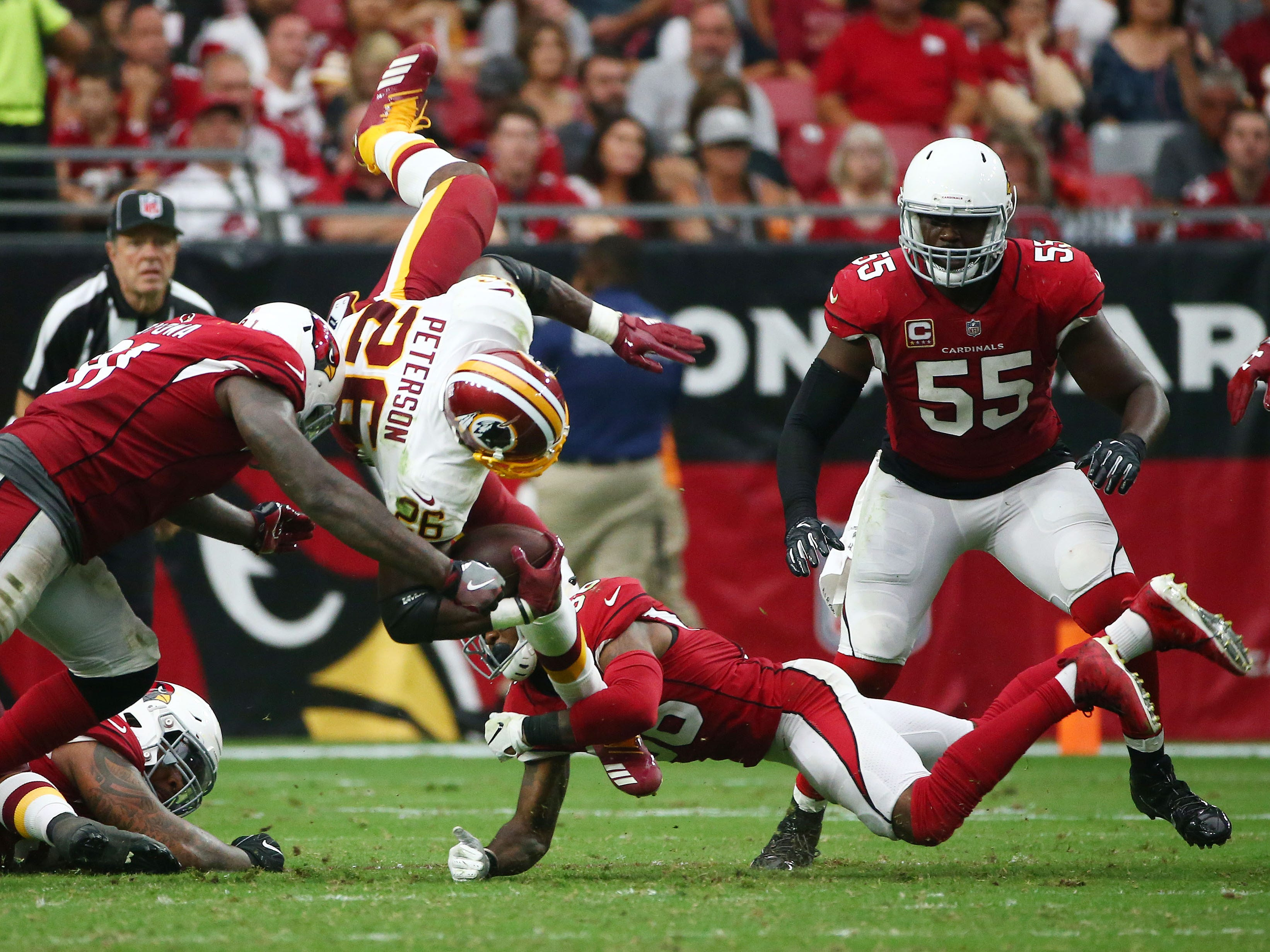 Arizona Cardinals Benson Mayowa (91) tackles Washington Redskins Adrian Peterson in the second half at State Farm Stadium.