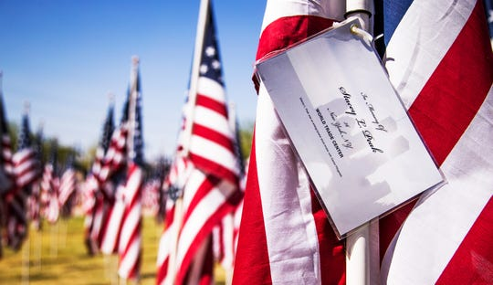 A flag honoring Stacey Peak, 36, a stockbroker who was killed in the World Trade Center attack on 9/11, is one of almost 3,000 flags that have been placed in the Healing Field at Tempe Beach Park to honor those killed on Sept. 11, 2001.