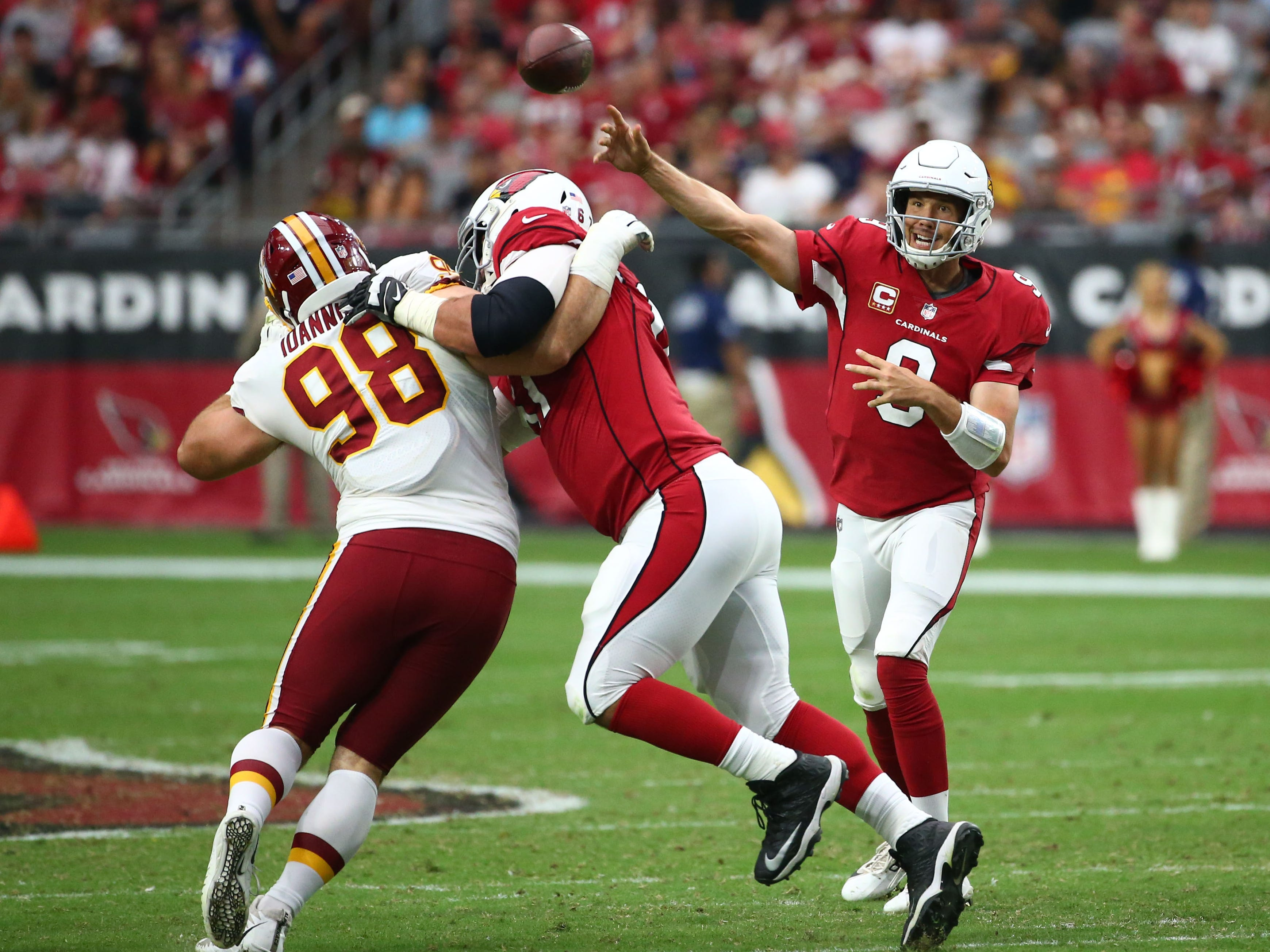 Arizona Cardinals quarterback Sam Bradford throw a pass against the Washington Redskins in the second half at State Farm Stadium.