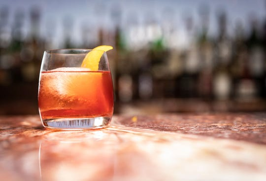 Mezcal Negroni cocktail with Sombra meszcal, Antica Carpano vermouth and Campari at J&G Steakhouse at the Phoenician Resort in Phoenix.