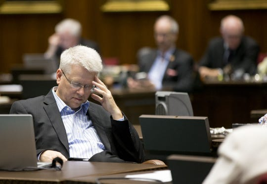 Rep. Eddie Farnsworth listens during voting on the House floor at the state Capitol in Phoenix on May 3, 2018.