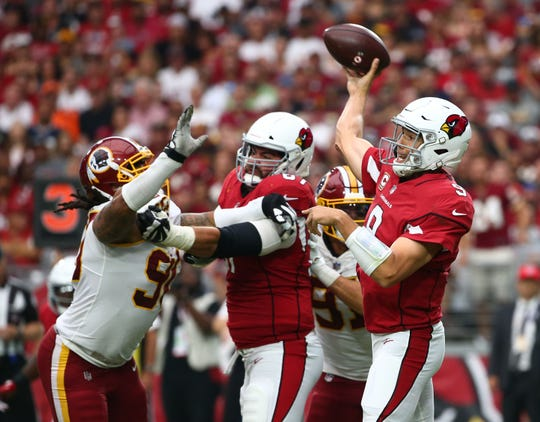 Arizona Cardinals quarterback Sam Bradford throes a pass against the Washington Redskins in the second half at State Farm Stadium.