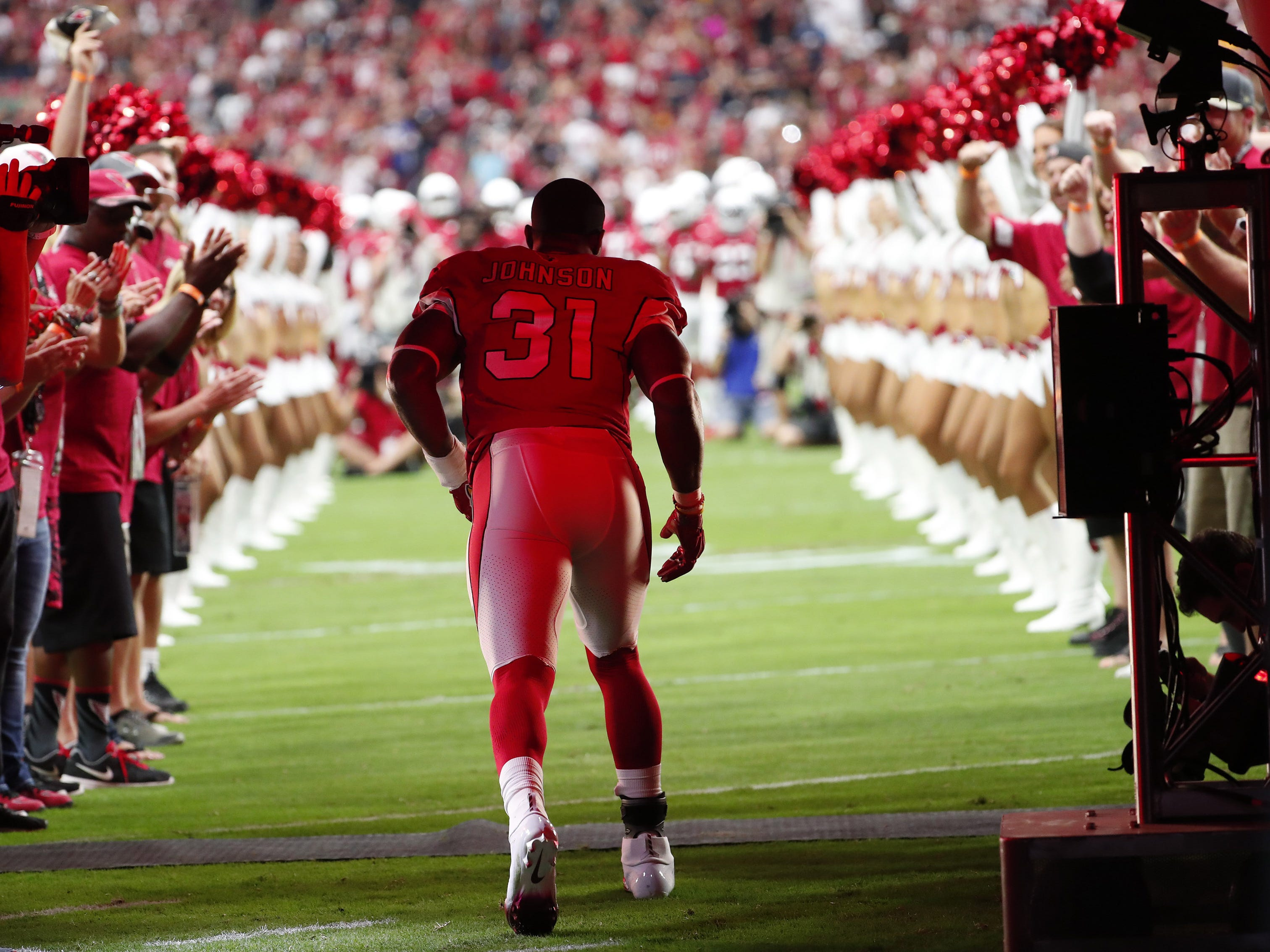 Arizona Cardinals running back David Johnson (31) is introduced before playing against the Washington Redskins at State Farm Stadium in Glendale, Ariz. September 9. 2018.