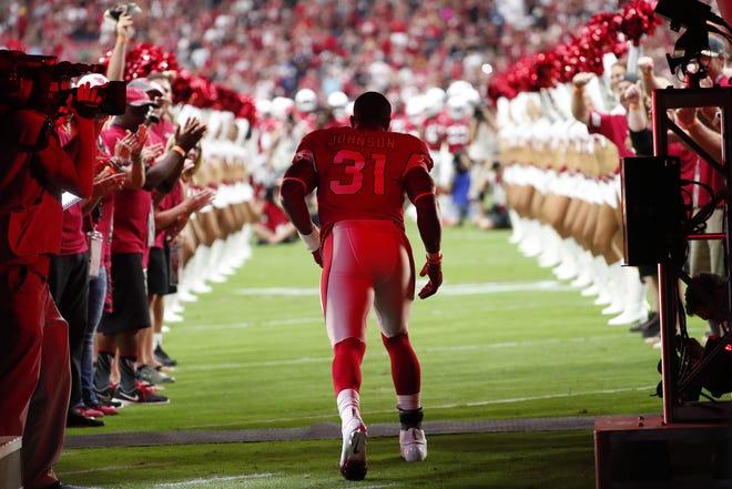 Arizona Cardinals running back David Johnson (31) is introduced before playing against the Washington Redskins at State Farm Stadium in Glendale, Ariz. September 9. 2018.