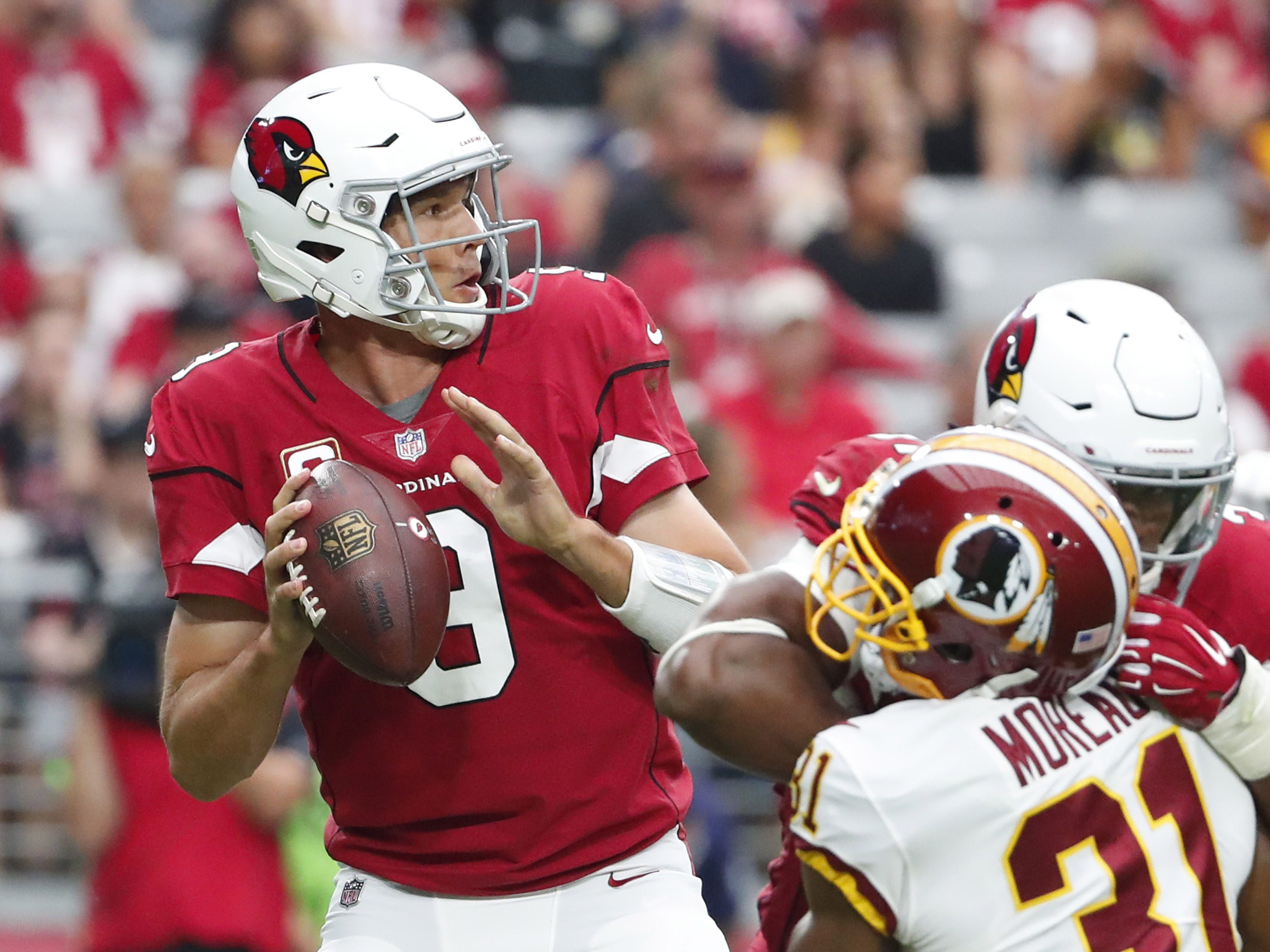 Arizona Cardinals quarterback Sam Bradford (9) throws against the Washington Redskins during the third quarter at State Farm Stadium in Glendale, Ariz. September 9. 2018.