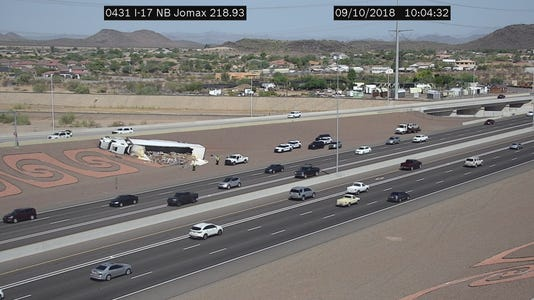 Semi-truck carrying kegs overturns on I-17