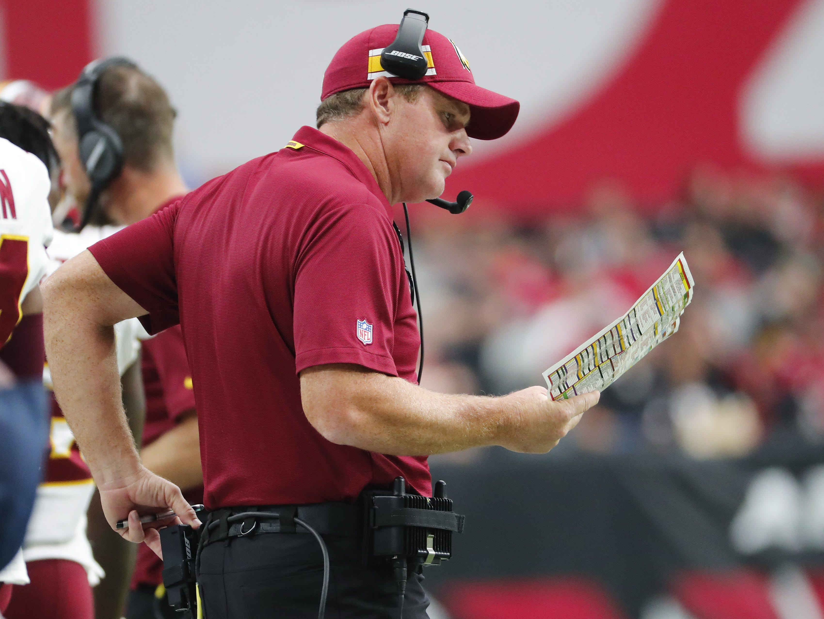 Washington Redskins head coach Jay Gruden looks at his play sheet during the third quarter against the Arizona Cardinals at State Farm Stadium in Glendale, Ariz. September 9. 2018.