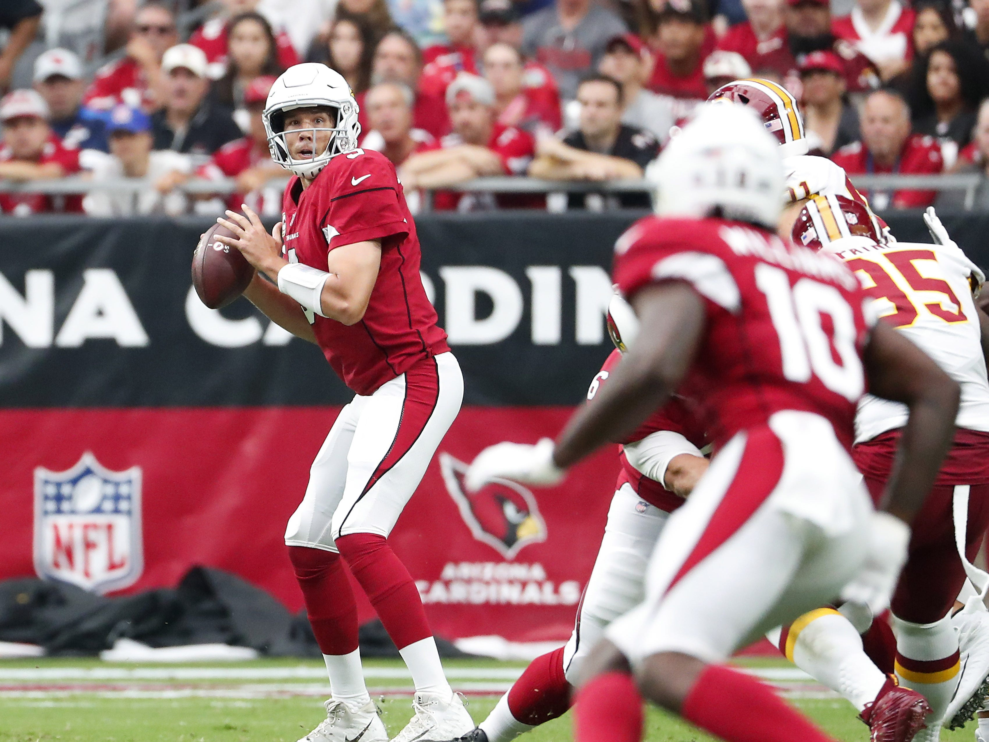 Arizona Cardinals quarterback Sam Bradford (9) looks to pass against the Washington Redskins during the first quarter at State Farm Stadium in Glendale, Ariz. September 9. 2018.