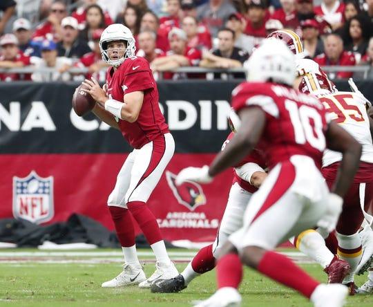 Cardinals quarterback Sam Bradford looks to pass against the Redskins on Sunday.