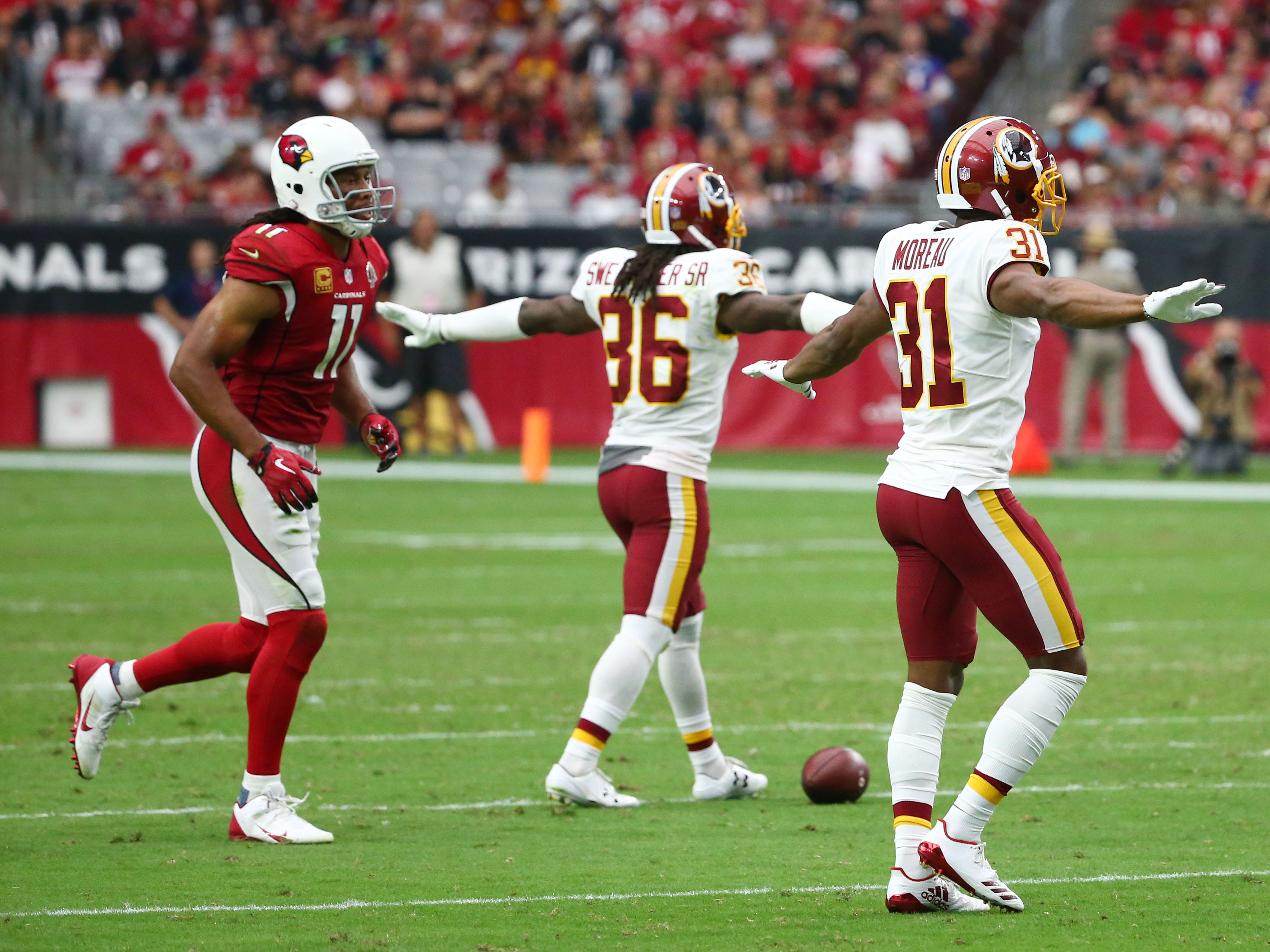 Arizona Cardinals wide receiver Larry Fitzgerald reacts after the Washington Redskins broke up a pass at State Farm Stadium.