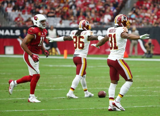 Larry Fitzgerald heads back to the line of scrimmage after the Redskins broke up a pass intended for the receiver during a game at State Farm Stadium.