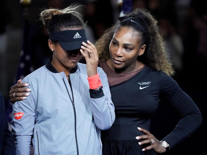 Serena Williams, right, comforts  Naomi Osaka of Japan as the crowd boos after the women's final at the U.S. Open.