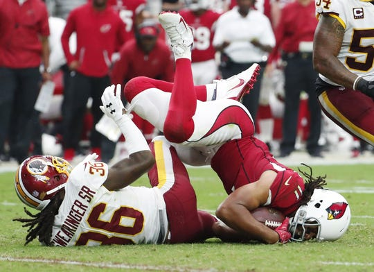 Larry Fitzgerald is tackled by Washington safety D.J. Swearinger during the third quarter of a game Sept. 9 at State Farm Stadium.