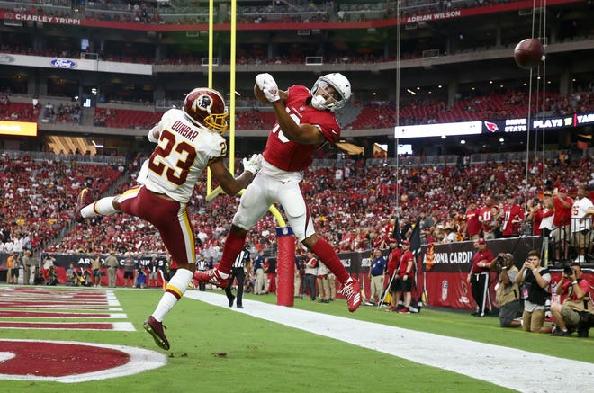 Arizona Cardinals Christian Kirk watches the ball sail over his head against the Washington Redskins in the second half at State Farm Stadium.