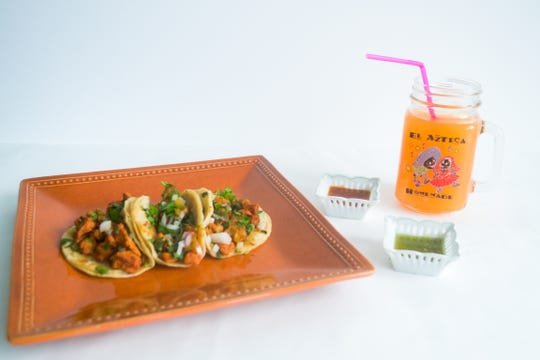 Al Pastor Mexican Tacos with Cantaloupe Juice makes a tasty lunch for $10 at El Azteca Mexicana in Poughkeepsie.