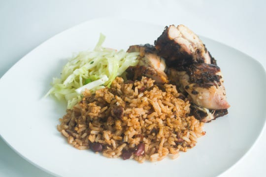 Jerk Chicken with rice and beans, and Jamaican-style slaw makes a satisfying lunch for under $10 at Montego Bay on Raymond Avenue in Poughkeepsie.