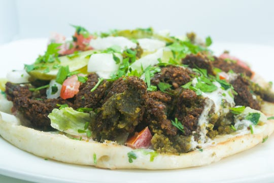 The Falafel Pizza is a new take on the classic recipe at Falafel Town in Poughkeepsie.