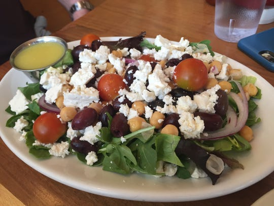 Greek Salad at Sissy's Cafe in Kingston includes arugula, chickpeas, kalamata olives, cherry tomatoes, feta cheese and red onion tossed.