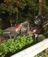 A Metal Township fireman  was injured when the fire truck he was driving overturned en route to a fire in Path Valley.