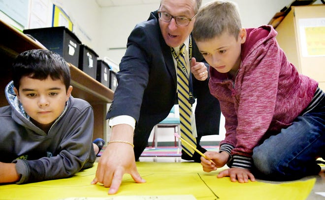 Eastern York School District's new superintendent, Joe Mancuso, looks at a mapping assignment with Wrightsville Elementary fourth-graders Hunter Tuscan, left, and Dominick Griffin at the school Monday, Sept. 10, 2018. Bill Kalina photo