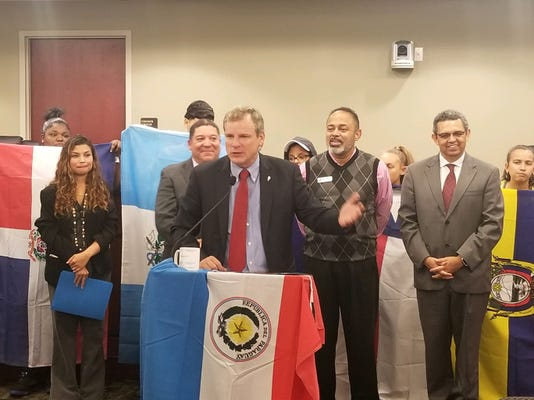 Mayor Michael Helfrich and others at Hispanic Heritage Month proclamation