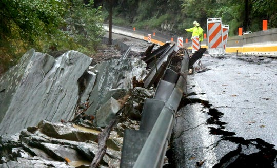 PennDOT officials assess damage to Accomac Road Monday, Sept. 10, 2018, after flooding damage closed the road to one lane of local traffic and emergency travel only. Bill Kalina photo