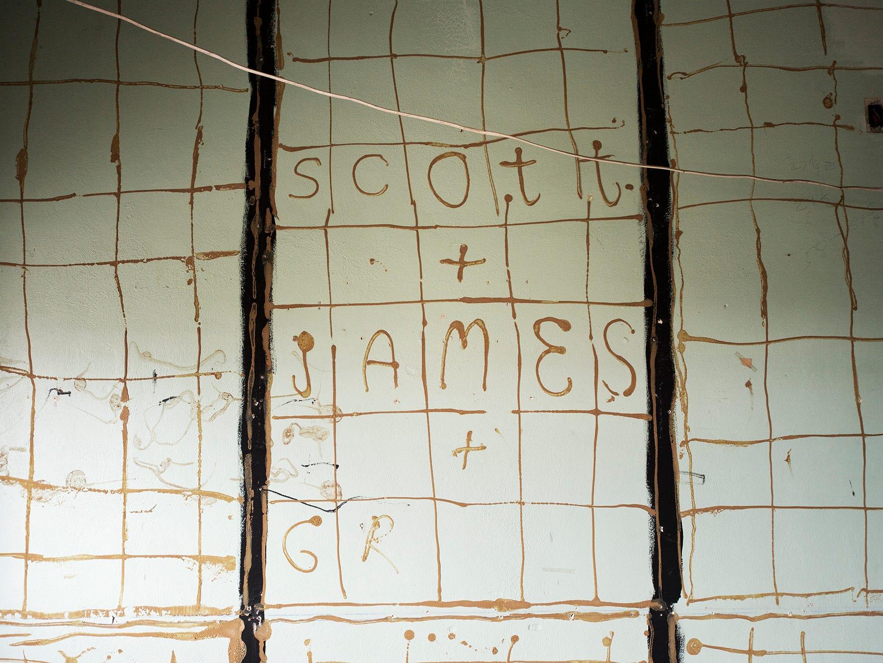 Names written in panelling glue were hidden beneath panelling at Rupp-Schmidt Building.