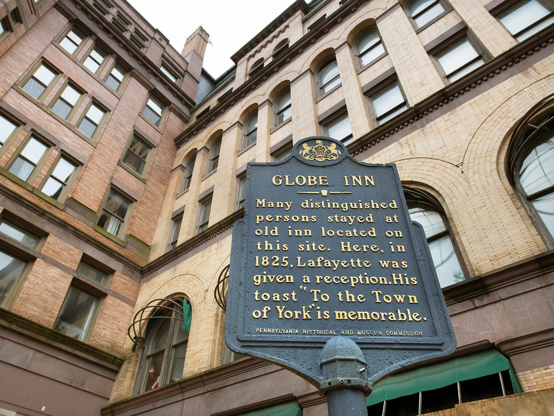 "A historical marker for the Globe Inn us in front of the Rupp-Schmidt Building at 2 West Market Street in York talks about a toast ""To the Town of York"" by Lafayette in 1825. The Inn was demolished prior to the 1892 construction of the current building."
