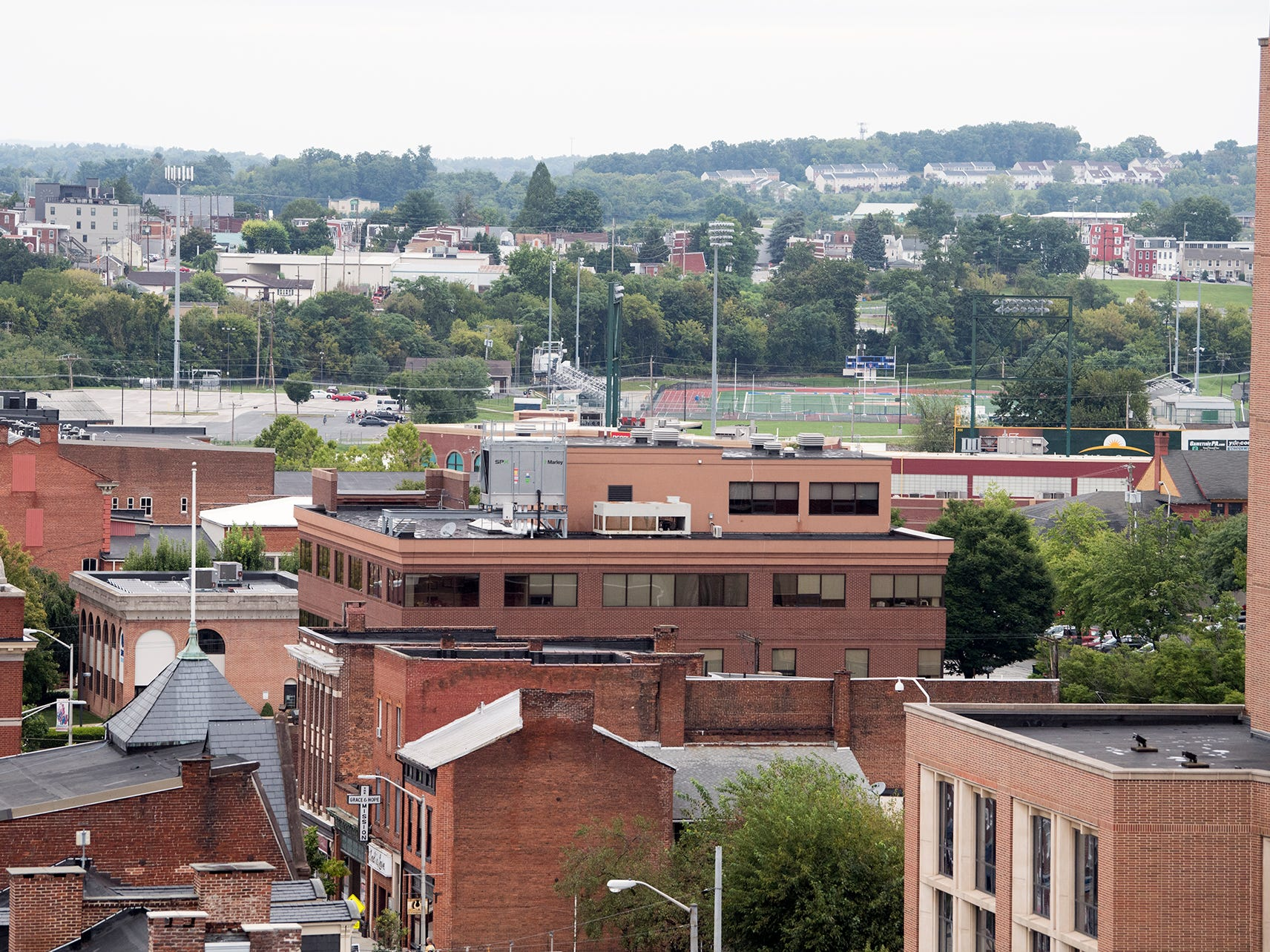 Looking north across North George Street from the Rupp-Schmidt Building at 2 West Market Street in York. The William Penn football field is visible at top right.