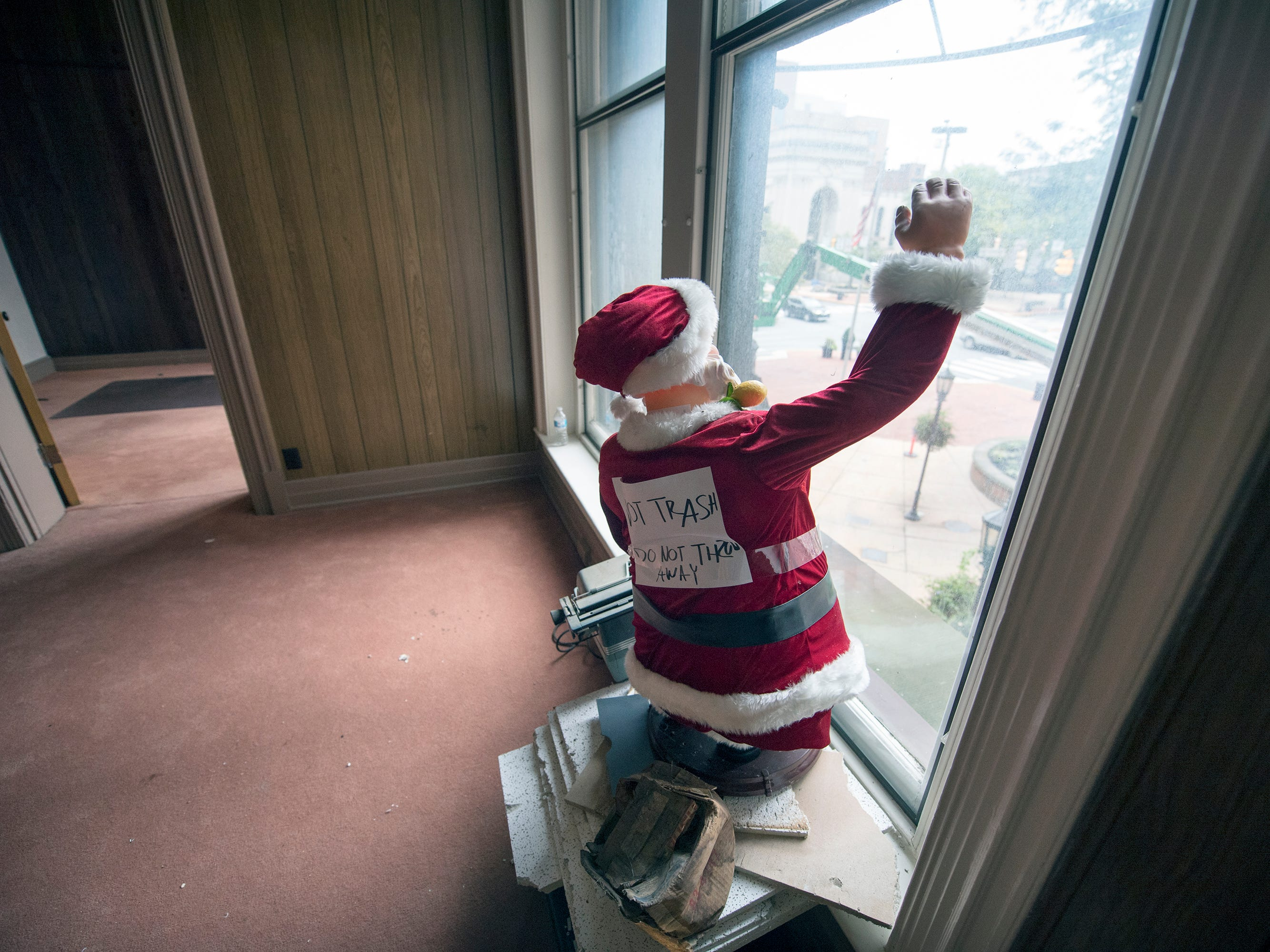 A Santa waves to Continental Square from the vacant second floor of the Rupp-Schmidt Building at 2 West Market Street in York.