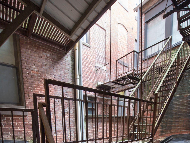 An interesting fire escape that winds it's way around an interior air sharft at the Rupp-Schmidt Building.