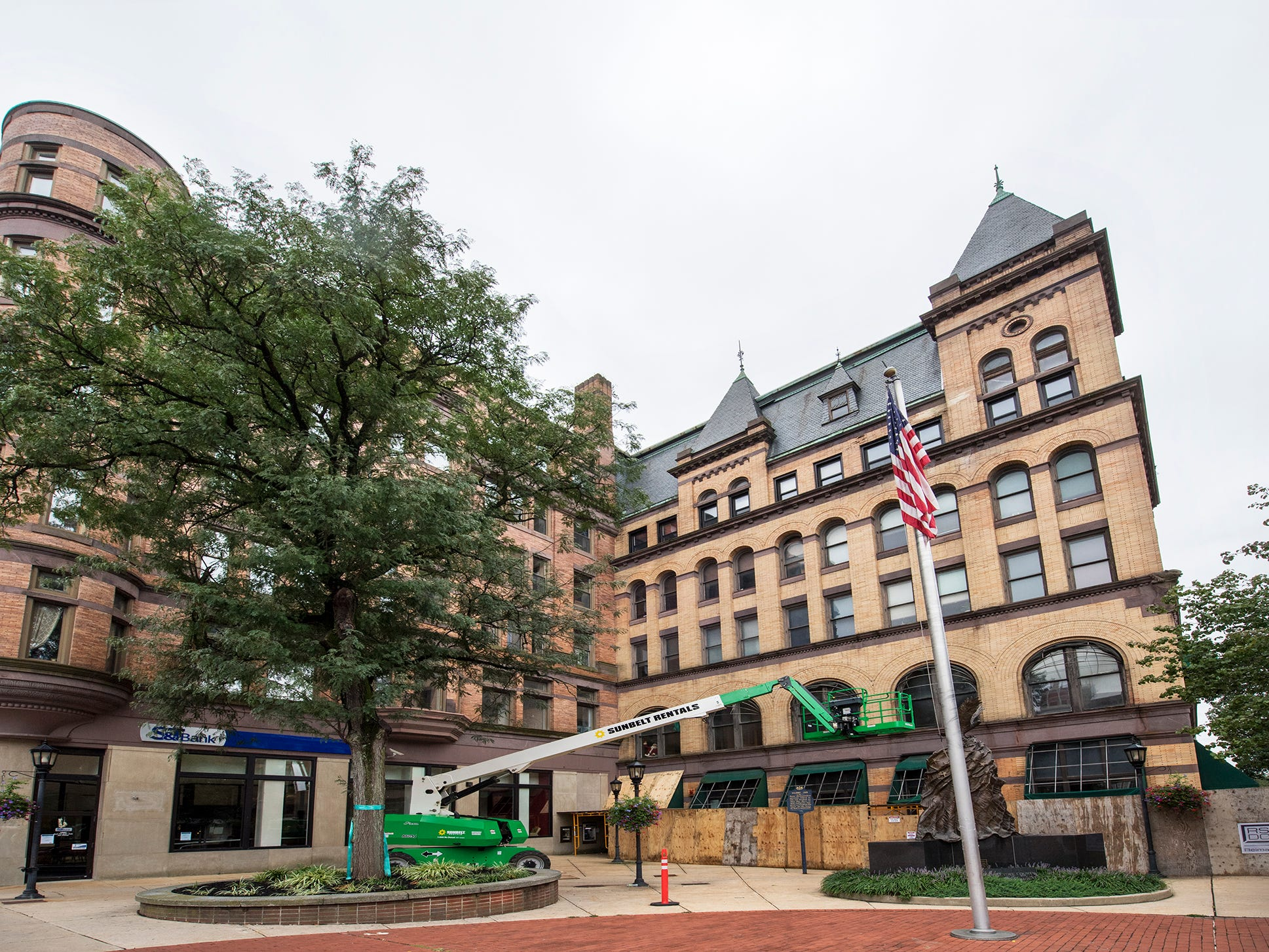 The Rupp-Schmidt Building, at right, at 2 West Market Street in York is in the process of exterior renovation by Royal Square Development & Construction (RSDC).