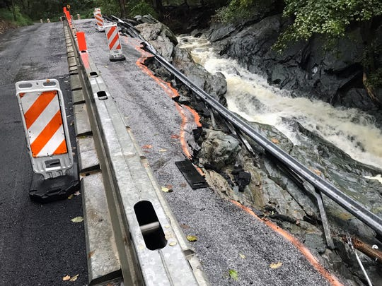 A section of Accomac Road in Hellam Township Monday morning is marked for inspection by engineers. It was determined that the base of the roadway, damaged in a previous flood, was washed out to almost the jersey wall after rain this weekend.