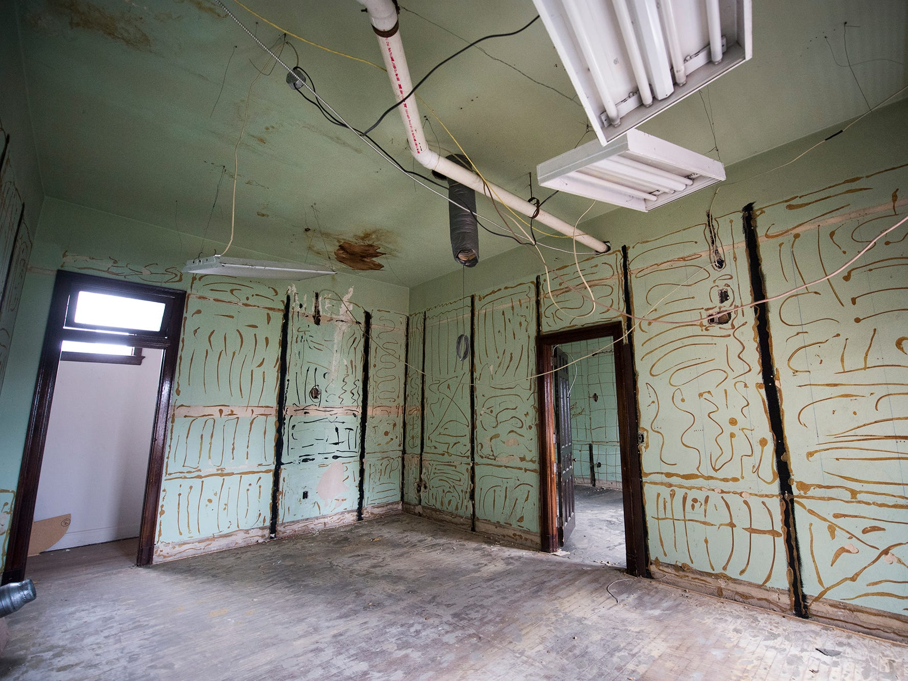 An upper floor of the Rupp-Schmidt Building at 2 West Market Street in York show evidence of panelling and a drop ceiling.