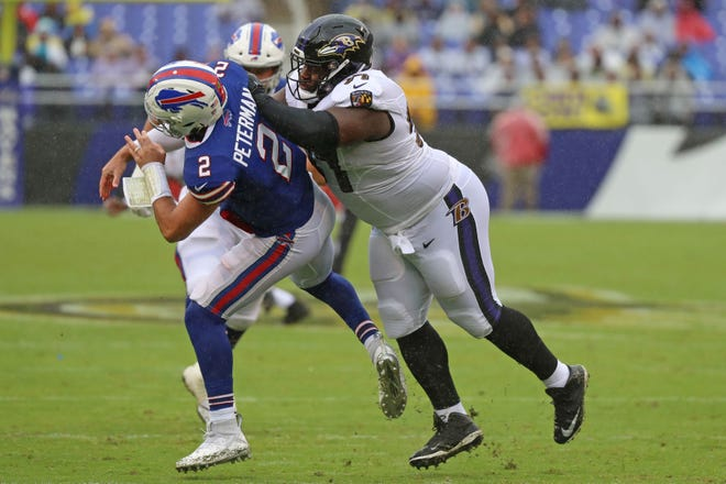 Baltimore Ravens tackle Michael Pierce (97) pressures Buffalo Bills quarterback Nathan Peterman (2) during the Ravens' 47-3 victory on Sunday. Peterman was pulled in the third quarter.